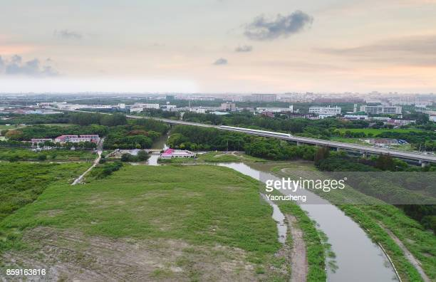 Aerial view of Shanghai magnetic levitation (maglev) train running on the trail