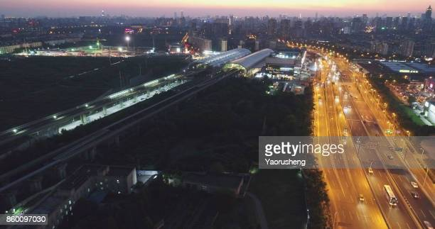 aerial view of shanghai metro station (left) and maglev station (right)