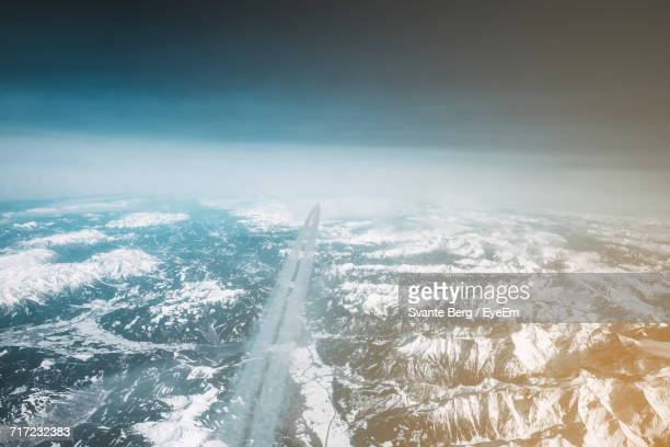 Aerial View Of Snow Coverd Landscape Against Sky