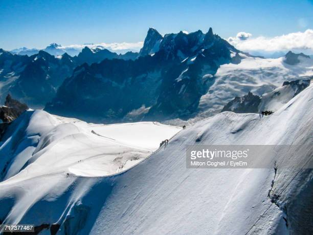Aerial View Of Snowcapped Mountain Range