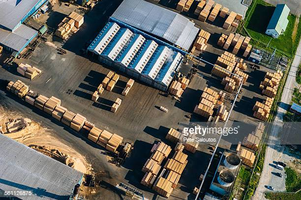 Aerial view of stacked planks in timber yard