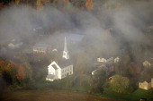 Aerial view of Stowe VT in Autumn on Scenic Route 100 through fog