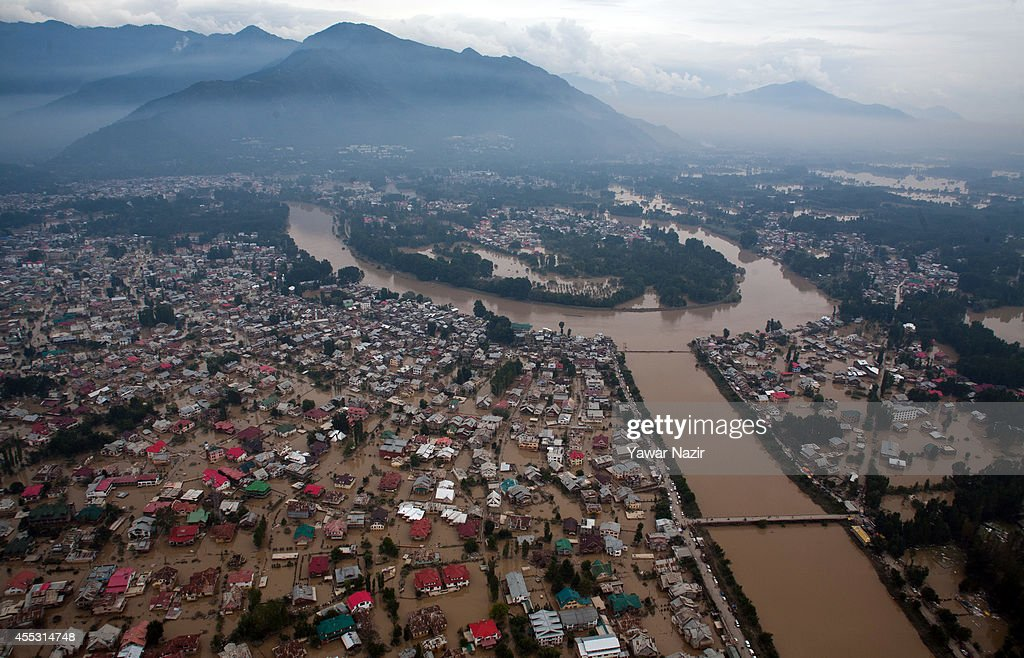 Aerial view of submerged residential houses in a flooded area on September 12 2014 in Srinagar the summer capital of Indian administered Kashmir...