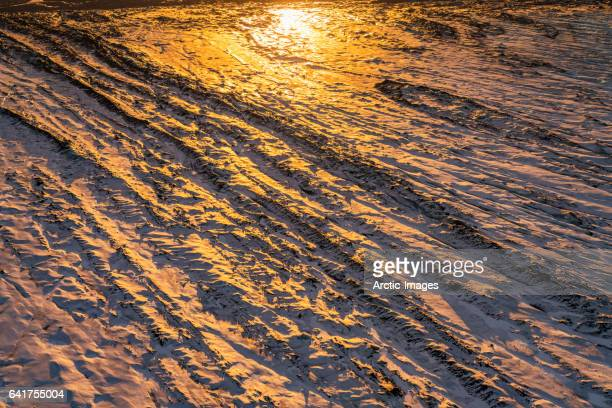 Aerial view of sun reflecting on a glacier, Iceland