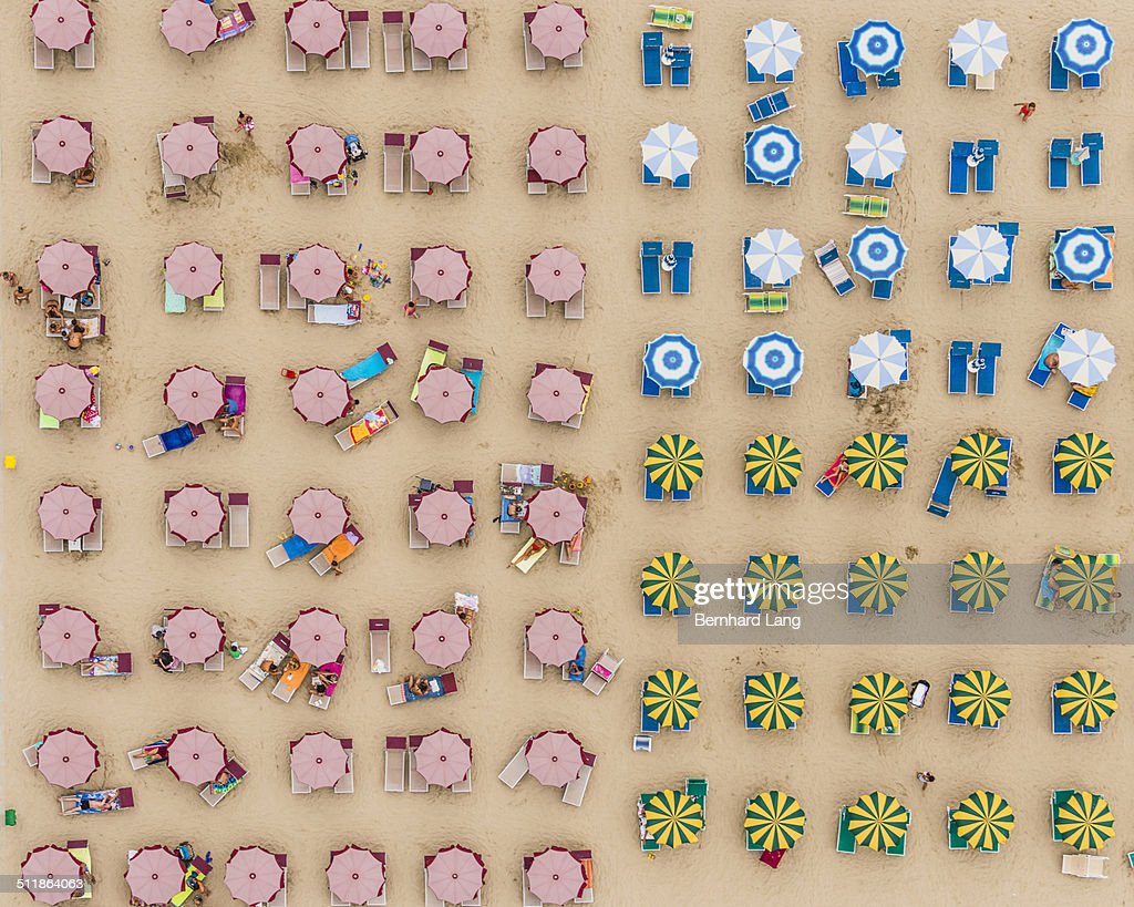 Aerial View of sunshades standing in the sand : Stock Photo