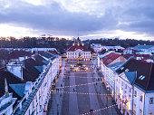 Aerial view of historical Tartu city hall (Raekoda) with Christmas decorations. Tartu, Estonia.