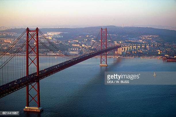 Aerial view of the 25th of April bridge over the Tagus river 19621966 connecting Lisbon to Almada Portugal 20th century