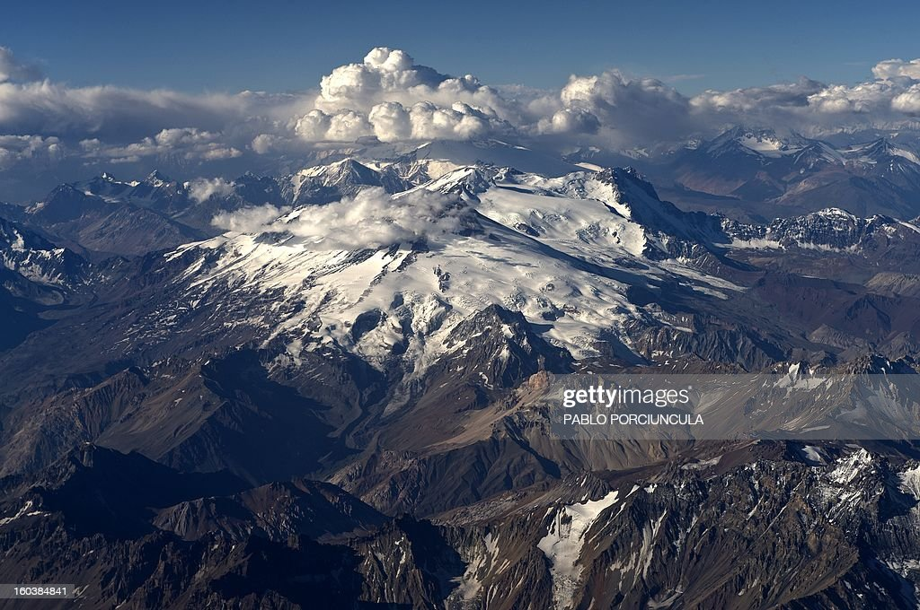 Aerial view of the Andes mountain range, near the border between Chile and Argentina, on January 29, 2013. AFP PHOTO/Pablo PORCIUNCULA