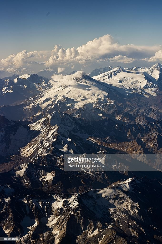 Aerial view of the Andes mountain range near the border between Chile and Argentina on January 29 2013 AFP PHOTO/Pablo PORCIUNCULA