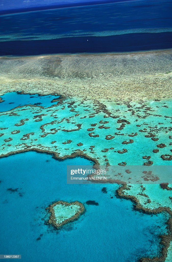 Aerial view of the aptly named Heart Reef a heartshaped coral reef in the Coral Sea in the Great Barrier Reef Whitsunday Islands off the coast of...