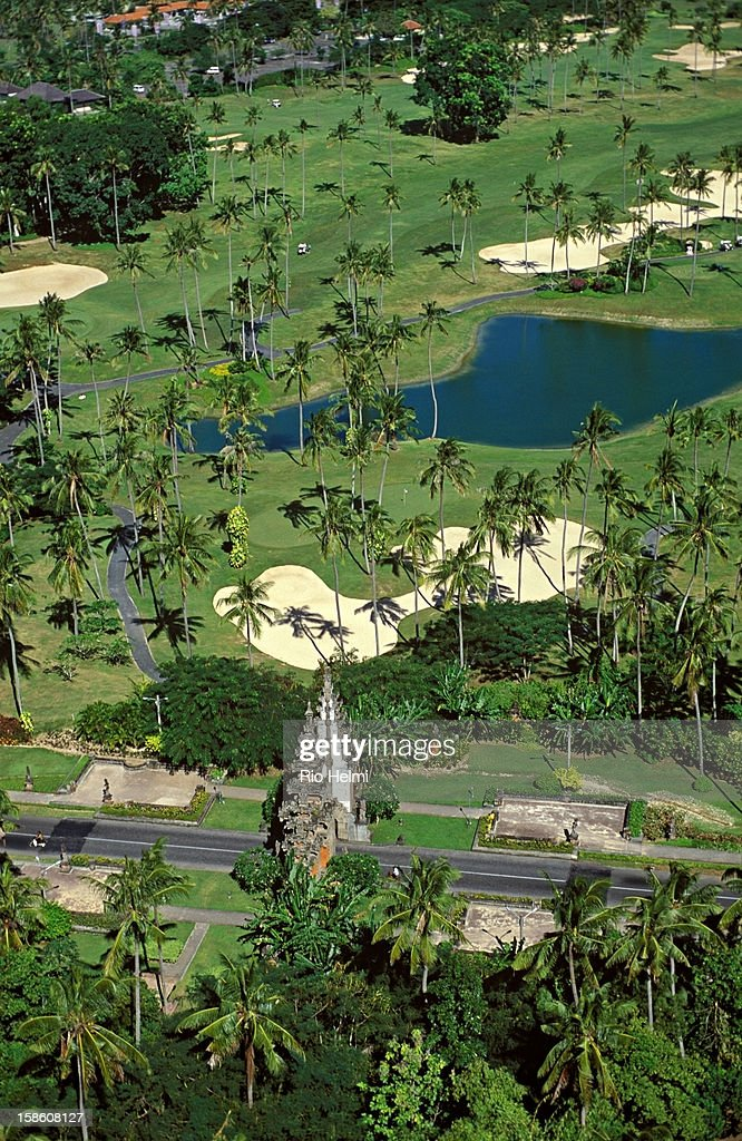 Aerial view of the Bali Golf and Country Club at Nusa Dua, with the entrance gate to the Nusa Dua BTDC hotel complex in foreground..