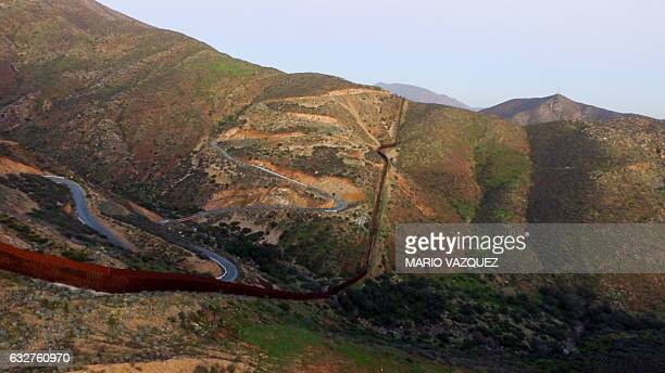 Aerial view of the border fence between Mexico and the US taken on January 25 2017 in Tijuana Mexico US President Donald Trump on Thursday told...
