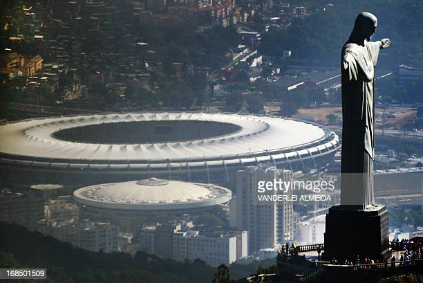 Aerial view of the Christ the Redeemer statue atop Corcovado Hill and the Mario Filho stadium in Rio de Janeiro Brazil on May 10 2013 The Maracana...