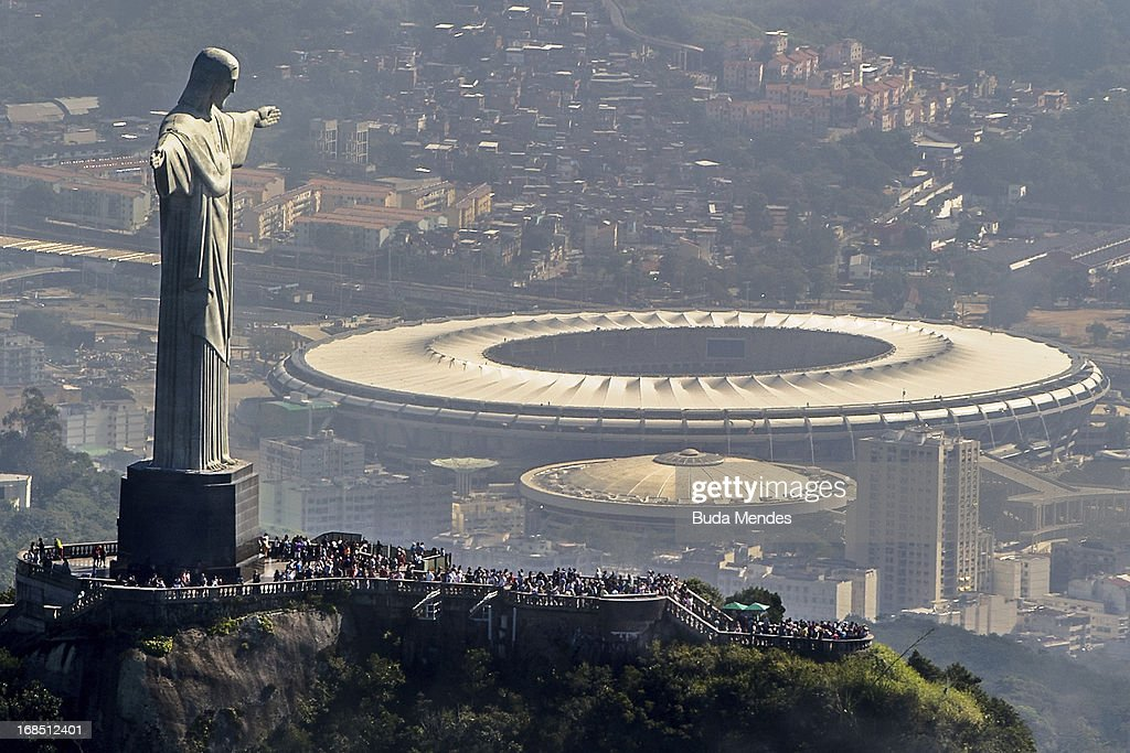 Aerial view of the Christ the Redeemer statue atop Corcovado Hill and the Mario Filho stadium on May 10 2013 in Rio de Janeiro Brazil The Maracana...