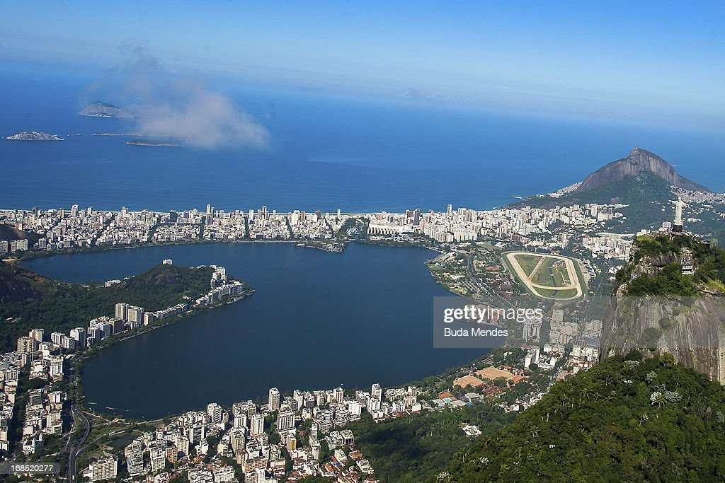 Aerial view of the Christ the Redeemer statue atop Corcovado Hill (foreground) and the Rodrigo de Freitas Lagoon on May 10, 2013 in Rio de Janeiro, Brazil. (Photo by Buda Mendes/LatinContent/Getty Images).