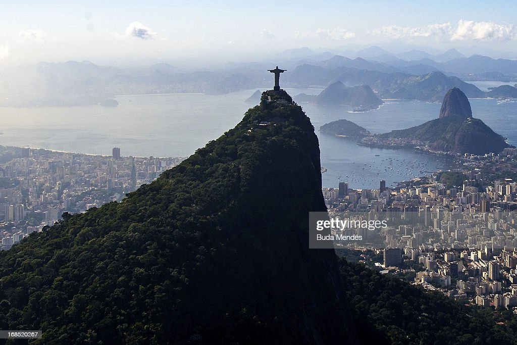 Aerial view of the Christ the Redeemer statue atop Corcovado Hill (foreground), the Sugar Loaf Hill (behind) and the Guanabara Bay on May 10, 2013 in Rio de Janeiro, Brazil. (Photo by Buda Mendes/LatinContent/Getty Images).