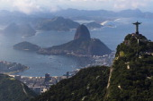 Aerial view of the Christ the Redeemer statue atop Corcovado Hill the Sugar Loaf Hill and the Guanabara Bay on May 10 2013 in Rio de Janeiro Brazil