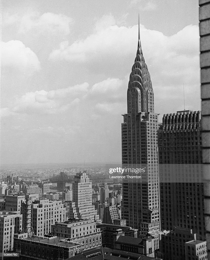 Aerial view of the Chrysler Building, in Midtown Manhattan, with the Chanin Building, visible on the left, New York, mid 20th Century.