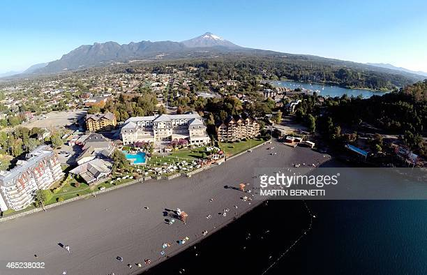 Aerial view of the city of Pucon some 800 km south of Santiago with the Villarrica volcano on the background showing no visible signs of activity...