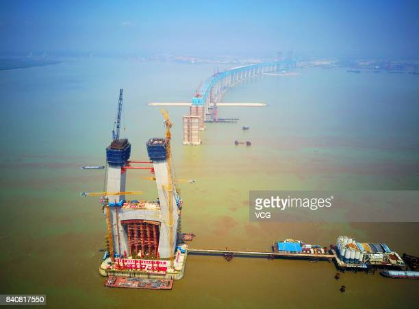 Aerial view of the construction site of the Hutong Railway Yangtze River Bridge across the Yangtze River on August 28 2017 in Nantong Jiangsu...