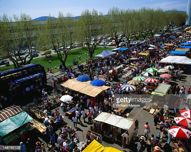Aerial view of the crowds, stalls and umbrellas of the colourful Salamanca Market - Hobart, Tasmania