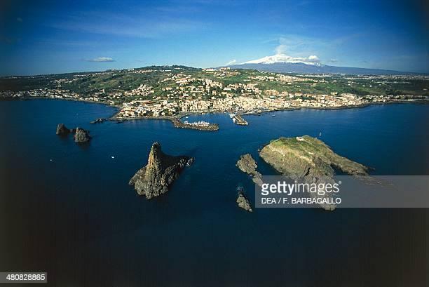 Aerial view of the Faraglioni dei Ciclopi tall rocks off the coast of Aci Trezza frazione of Aci Castello Province of Catania Sicily Region Italy