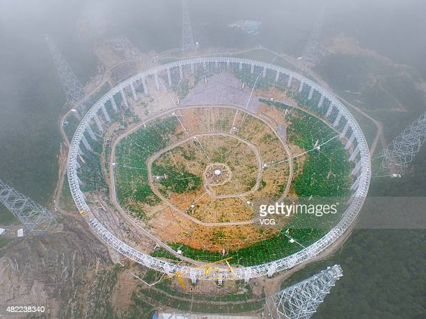 Aerial view of the Five hundred meter Aperture Spherical Telescope built in mountains on July 28 2015 in Pingtang County Qiannan Buyei and Miao...