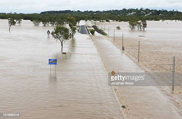 Aerial view of the highway into town submerged under flood waters on January 6 2011 in Rockhampton Australia Floodwaters peaked at 92 metres...