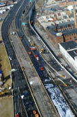 Aerial view of the I95 overpass in Bridgeport Conn shows emergency workers still on the scene after an oil tanker crashed and burst into a ball of...