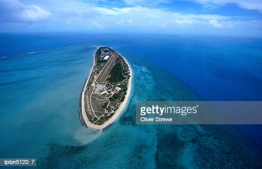 Aerial view of the island, also known locally as Poruma, surrounded by shallow coral reefs., Coconut Island, Queensland, Australia, Australasia