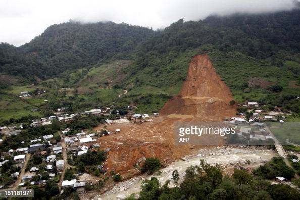 Aerial view of the landslide that buried part of La Pintada village Guerrero state Mexico after heavy rains hit the area on September 19 2013 Deaths...