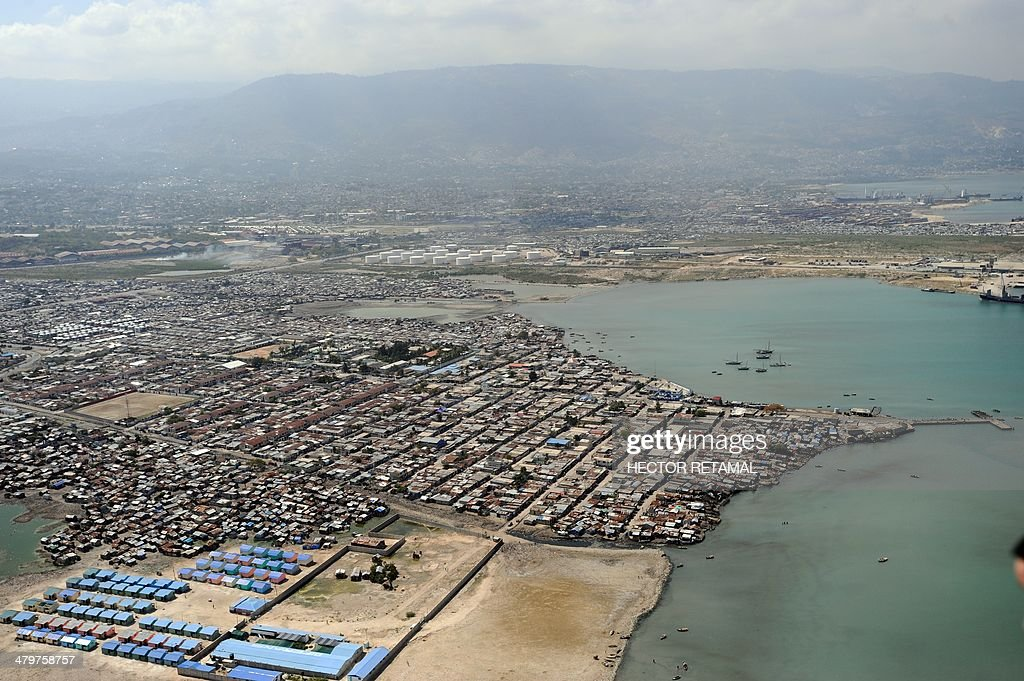 Aerial View of the metropolitan area of PortauPrince Cite Soleil and Port au Prince on March 20 2014 AFP PHOTO/Hector RETAMAL