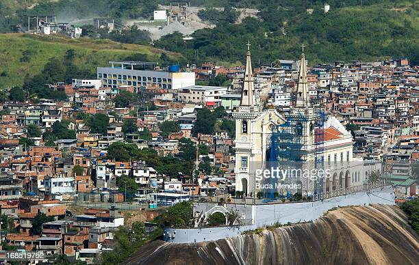 Aerial view of the Our Lady of Penha church situated on the crest a hill next to the Alemao shantytown complex on May 10 2013 in Rio de Janeiro Brazil