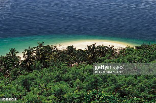Aerial view of the rainforest and a sandy beach Nosy Tanikely island Madagascar