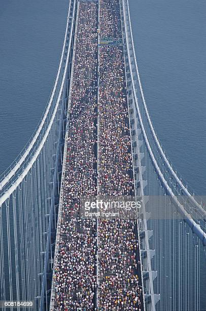 Aerial view of the runners as they cross the VerrazanoNarrows Bridge after the start of the the New York Marathon on 14 November 1993 at Staten...