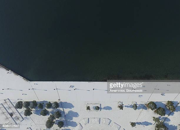 Aerial view of the snowed Thessaloniki waterfront on January 12 2017 in Thessaloniki Greece Thessaloniki often referred to internationally as...