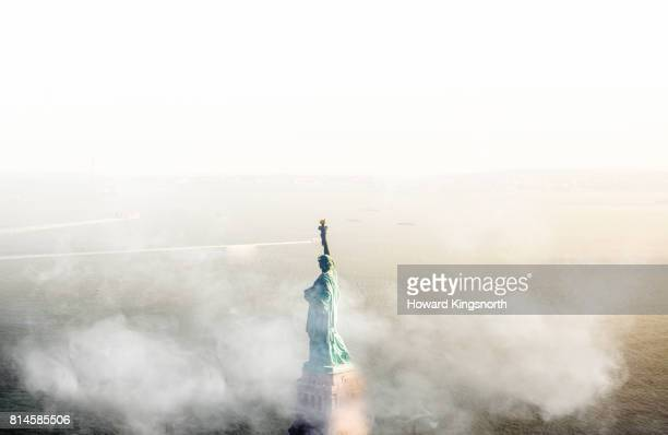 Aerial view of The Statue of Liberty with foggy sky