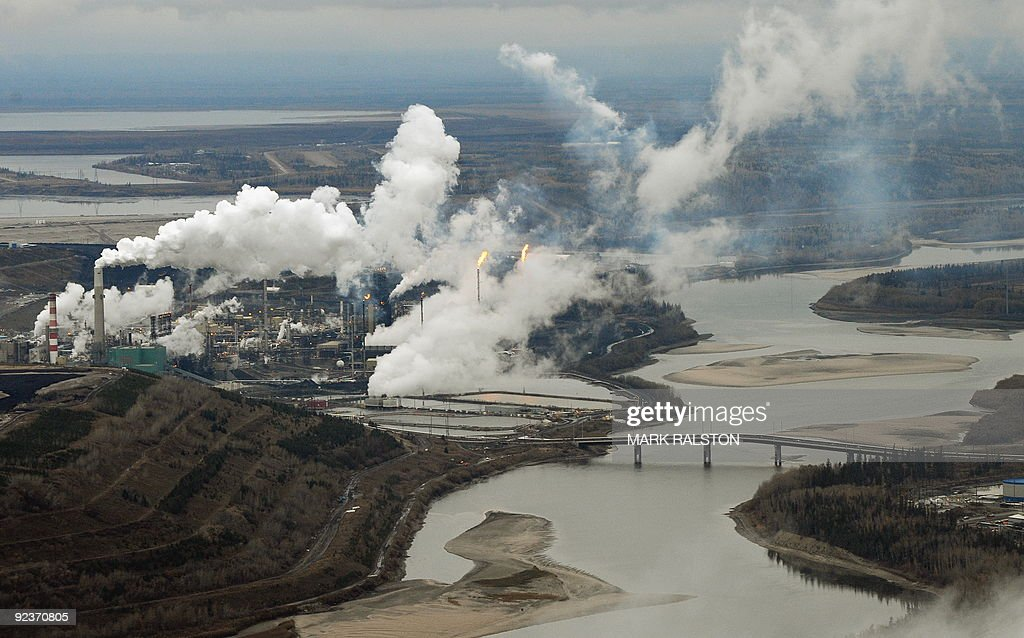 Aerial view of the Suncor oil sands extraction facility on the banks of the Athabasca River and near the town of Fort McMurray in Alberta Province...