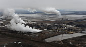 Aerial view of the Syncrude oil sands extraction facility with the Suncor extraction facility in the background near the town of Fort McMurray in...