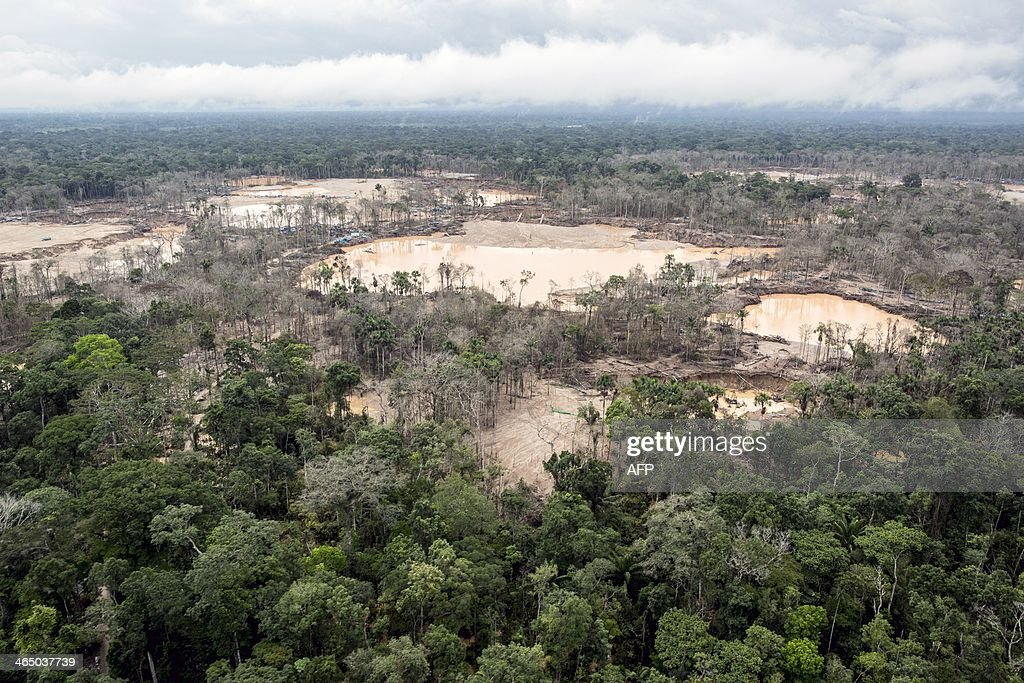 Aerial view of the tailings produced by illegal gold mining in Mega 13, Madre de Dios region, Peru, on January 25, 2014, during a police operation. AFP PHOTO / Sebastian Castañeda