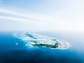 Aerial view of the tropical island with resort. Maldives