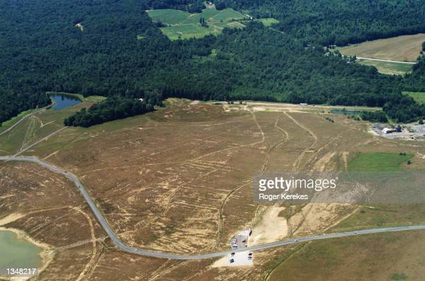 Aerial view of the United Flight 93 crash site and temporary memorial is seen July 26 2002 near Shanksville Pennsylvania The September 11 hijacked...