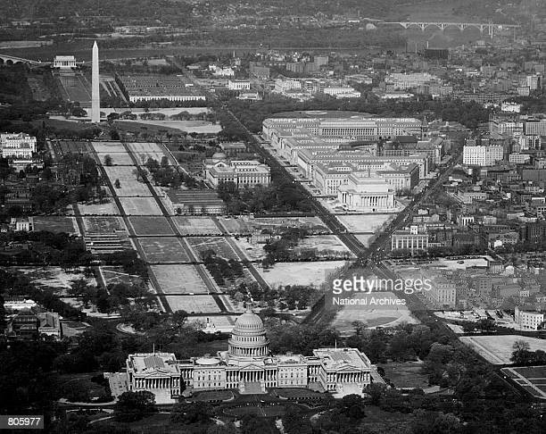 Aerial view of the US Capitol with the Washington Monument and Fedral Triangle in the background Photo taken June 15 1936