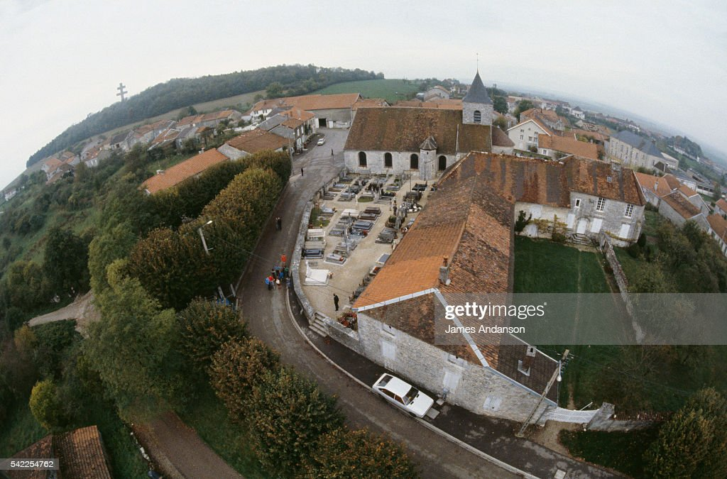 Aerial view of the village of ColombeylesDeuxÉglises with the cemetery in foreground and lightcolored gravestone of General de Gaulle buried in...