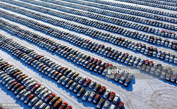 Aerial view of thousands of new cars lining up at a parking lot on January 16 2017 in Shenyang Liaoning Province of China