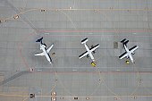Aerial view of three parked airplanes