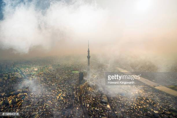 Aerial view of Tokyo with clouds and misty sky