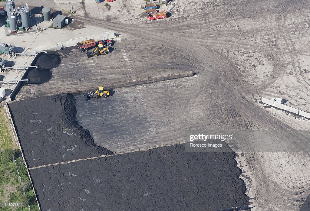 Aerial view of tractors at work in quarry : Stock Photo
