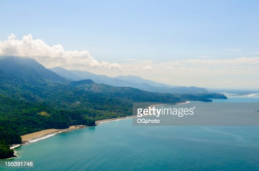 Aerial view of tropical forests from mountains to coast.