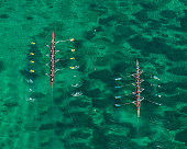 Aerial view of two 8-seat rowing crews racing